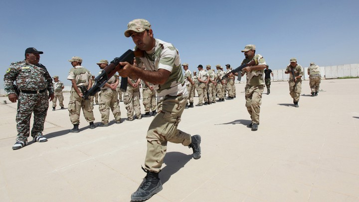 Iraqi Christians volunteers, who have joined Hash'd al Shaabi (Popular Mobilization), allied with Iraqi forces against the ISIS, take part in a training at a military camp in Baghdad in 2015.