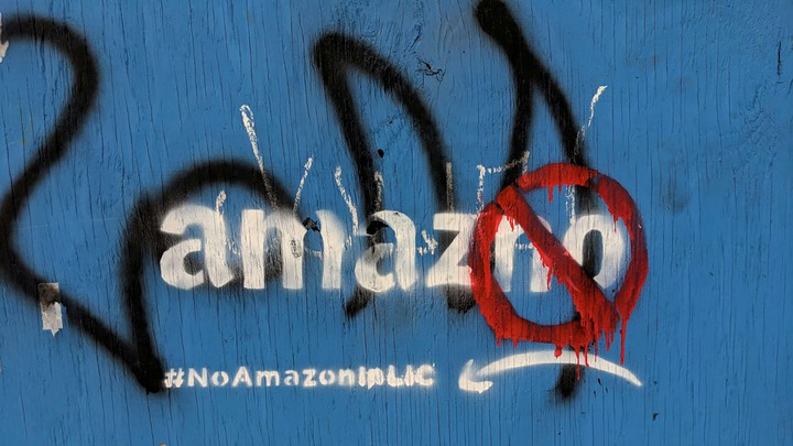 Graffiti opposing the construction of the new Amazon campus covers a fence in Long Island City, Queens.