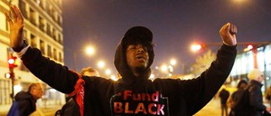 A demonstrator chants as he marches through the streets during protests in Chicago.
