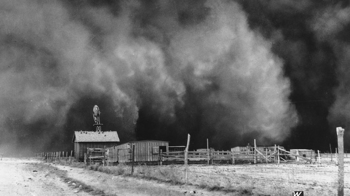 A ranch in Boise City, Oklahoma, is about to be encompassed by a gulf cloud in April 1935.