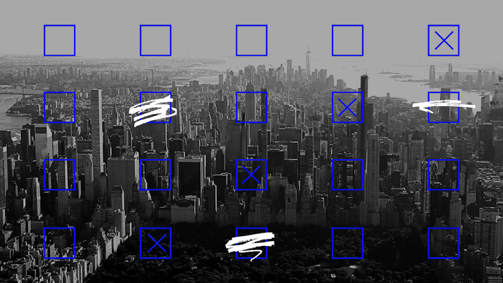 An aerial view of New York City overlaid with a grid of blue checkboxes