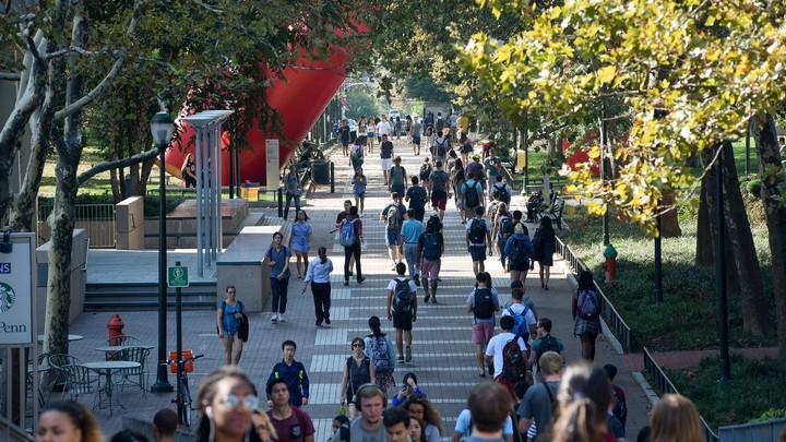 Students walking on a university sidewalk