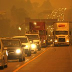 Traffic on a Colorado highway is engulfed in smoke from a wildfire in 2012.