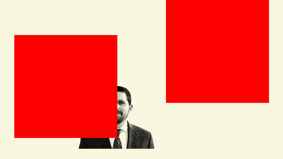 John Seago surrounded by red graphical blocks