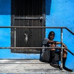 photo: A 59-year-old-man named Al sits outside his house in a low-income neighborhood in Miami in April.