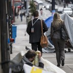 photo: Pedestrians walk past tents on Taylor Street in San Francisco, California, U.S., on Monday, Jan. 13, 2020.
