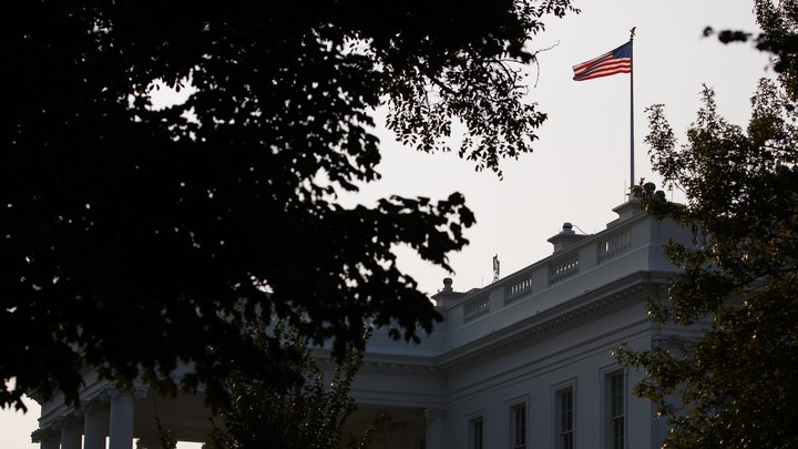 The U.S. flag flies at full-staff over the White House on Monday.