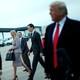 Ivanka Trump and Jared Kushner pass behind Donald Trump.