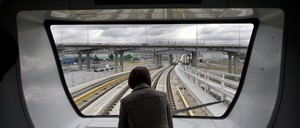 a photo of a woman on a SkyTrain car its way to the airport in Vancouver, British Columbia.