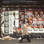 A man walks by a Black Panther poster in 1990s Harlem.