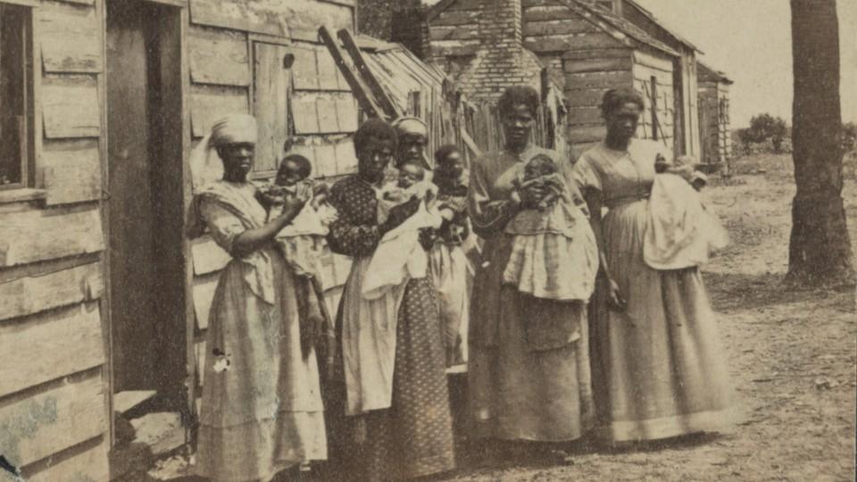 A photograph showing women holding babies