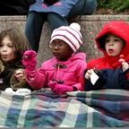 Little kids under a blanket.