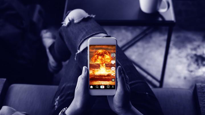 A phone screen showing a mushroom-cloud explosion
