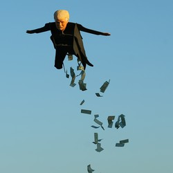 A remote-control plane resembling Donald Trump releases fake money as it flies over a beach in Southern California.