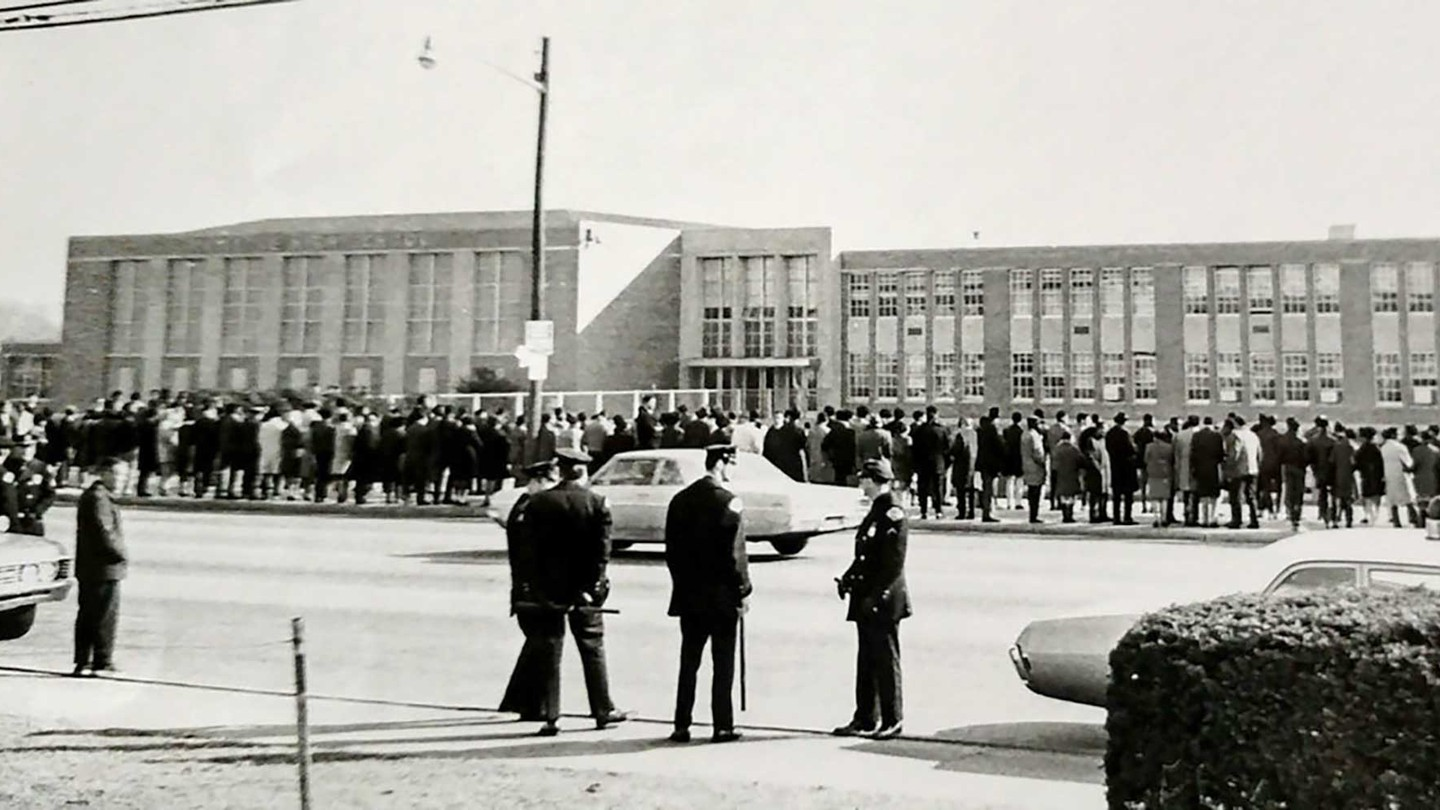 In 1963, residents crowded Ocean Avenue, in front of Malverne High School, to protest plans to integrate Malverne's public schools.