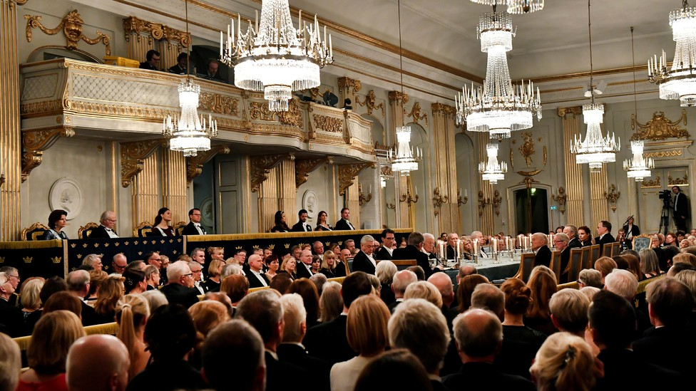 People sitting in a ballroom