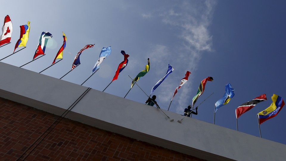 A photo taken from below a row of flags from around the world