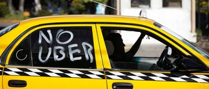 A San Salvador taxi driver takes part in a demonstration against Uber.