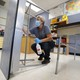 A custodian cleans a desk at a school in Des Moines, Iowa.