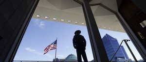 A State Capitol police officer stands watch outside the North Carolina Legislature in Raleigh, N.C.