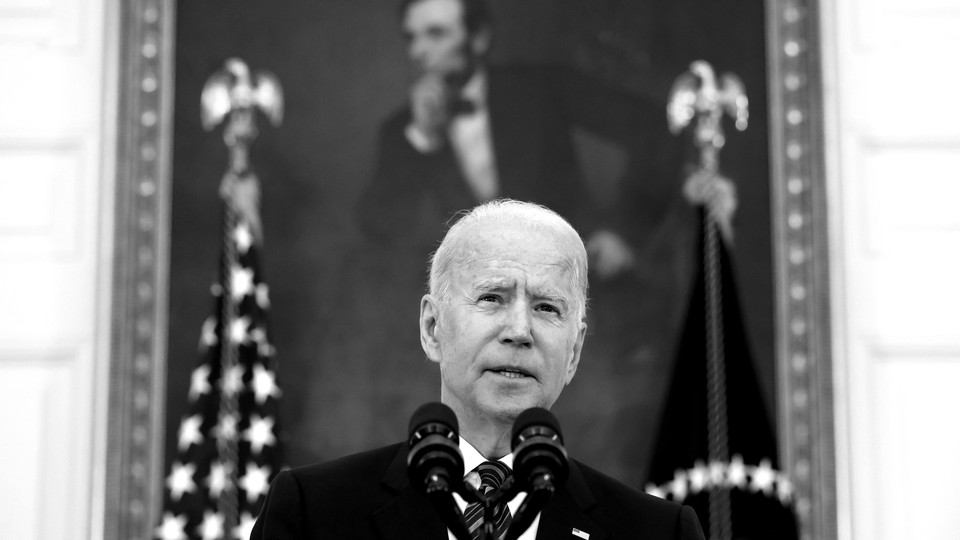 Joe Biden speaking at the White House with a portrait of Abraham Lincoln behind him