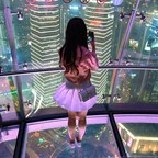 a photo of a woman taking a photograph in a Shanghai skyscraper