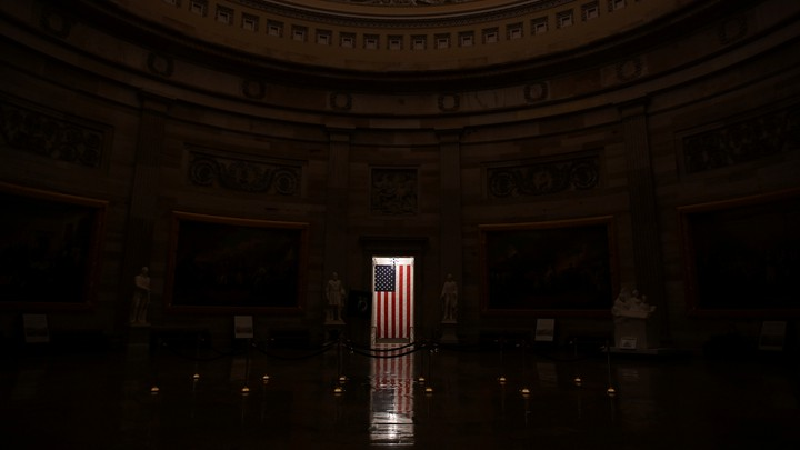 A flag inside the U.S. Capitol